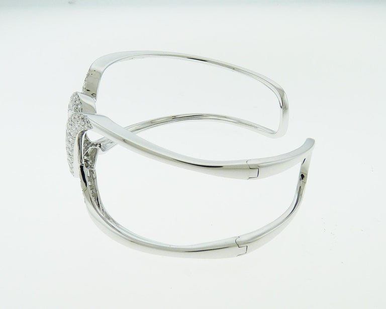 Beautiful bangle embellished with round diamonds weighing total 2.31 carats. Made in white gold.  The diamonds are equivalent to G-I colors, VS-SI clarity.  The weight of the bangle is 24.32 grams. Also available in rose and yellow gold for the same