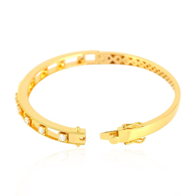 This lovely oval shape diamond 18K yellow gold bangle is open-able on side with open box clasp with safety locks on side. This is a very fine bangle to stack with your favorite bangles.   18Kt: 18.116g Diamond: 0.82Ct