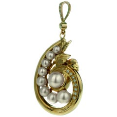 Diamond and Akoya Sea-Water Cultured Pearl Spiral Shell Pendant in 18 Carat Gold
