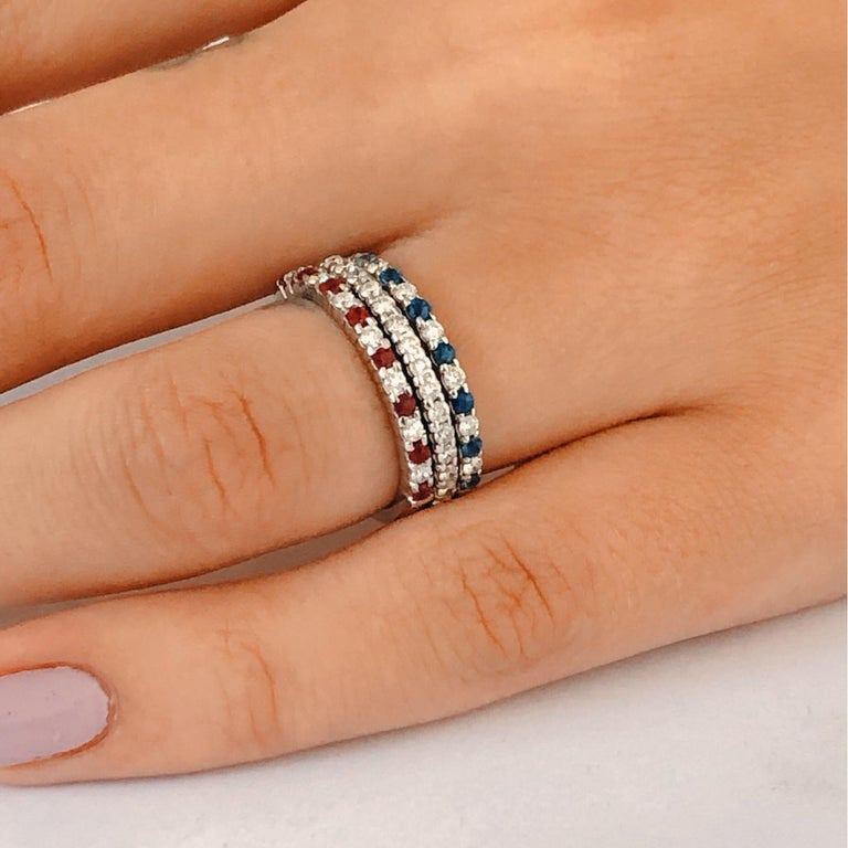 Eighteen Karat white gold prong set partial ring  Fifteen stones  Alternating diamond weighing 0.15 carat  Ruby weighing 0.20 carat  Anniversary or stacking band Diamond quality G VS New Ring Our team of graduate gemologists carefully hand-select