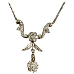Diamond and 14 Karat White Gold Pendant and Necklace