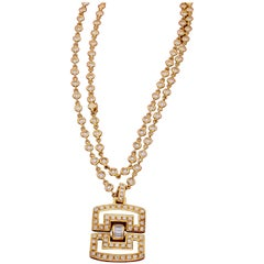 Diamond and 18 Karat Gold Long Chain and Pendant