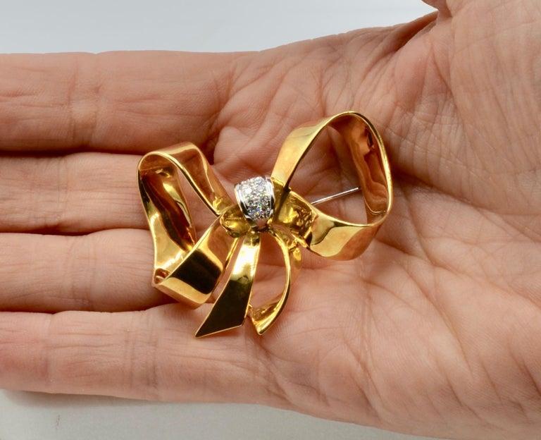 Round Cut Diamond and 18 Karat Italian Ribbon Bow Brooch For Sale