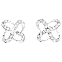 Diamond and 18 Karat White Gold Intersecting Bow Earrings, 0.45 Carat Diamonds