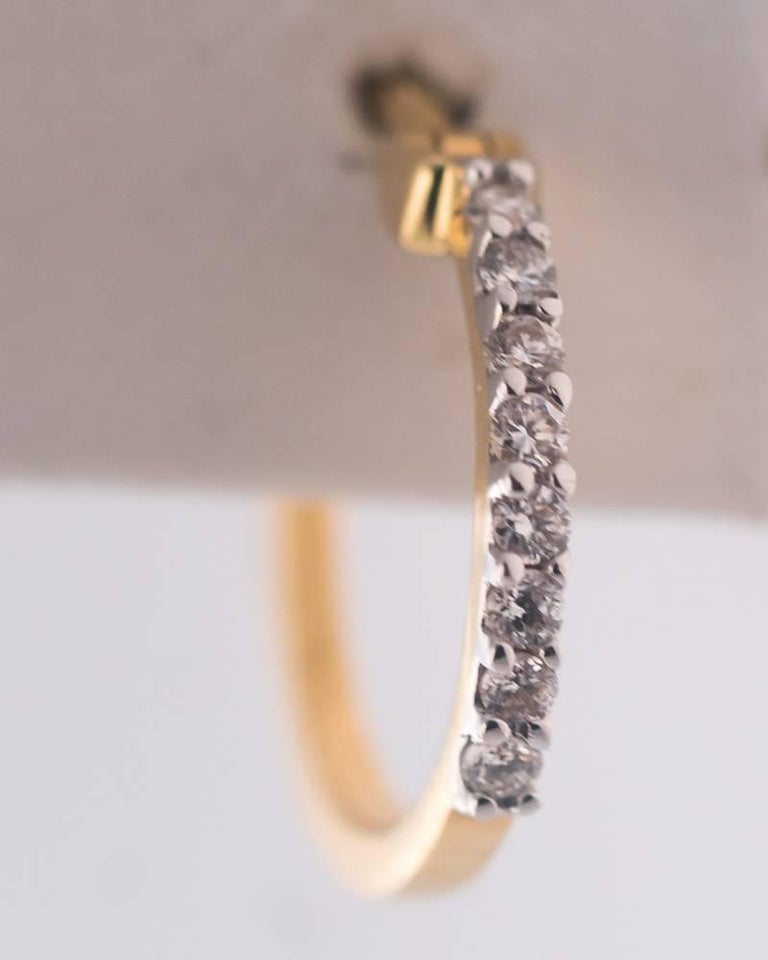 Round Cut Diamond and 18 Karat Yellow Gold Mini Hoop Earrings For Sale