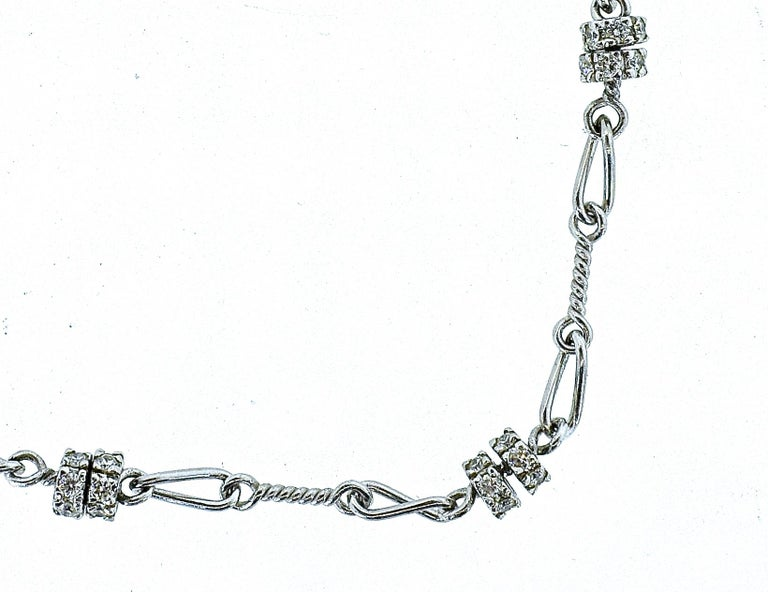 18K white gold chain interspersed with diamond roundels   The diamonds are all white brilliant cut diamonds amounting to approximately 1.4 cts.  The necklace is 16 inches long, 8.14 grams.   In excellent condition and never worn.