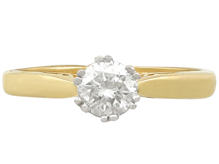 A fine and impressive antique 0.56 carat diamond and 18 carat yellow gold, 18 carat white gold set solitaire engagement ring; part of our diamond jewelry and estate jewelry collections  This fine and impressive diamond solitaire ring has been