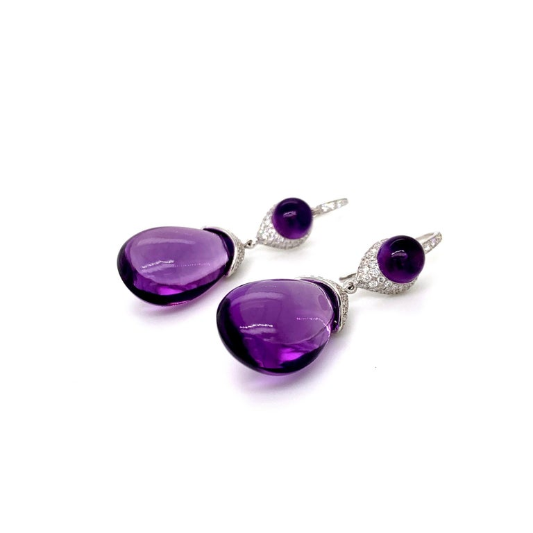 Beautiful pair of dangling diamond earrings with stunning amethyst drops.  •Total Diamond Weight: 1.39 carats  •Amethyst Weight: 39.69 carats •Diamond Quality/Colour: VS/FG (Clean, White)