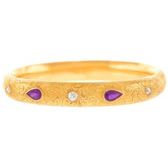 Diamond and Amethyst Set Riker Brothers 14 Karat Yellow Gold Bangle