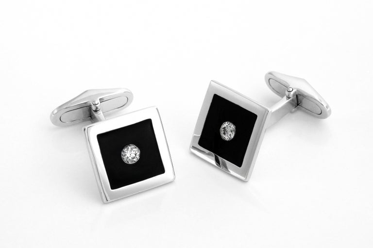 These enamel and diamond cufflinks were created for the sophiscated gent who loves to dress up but not be over stated. Made in 18k gold and set with two diamonds, they are the perfect accessory for the stylish man about town.