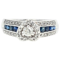 AJD Delicate Eye-Catching Diamond and Blue Sapphire Platinaire Ring