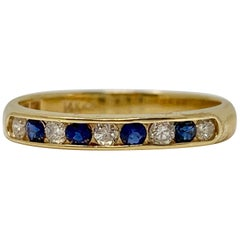 Diamond and Blue Sapphire Wedding Band in Yellow Gold