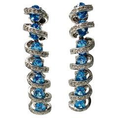 Diamond and Blue Topaz Earrings in 18 Karat White Gold