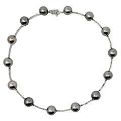 Diamond and Cultured Tahitian Silver Pearl 14 Karat White Gold Station Necklace