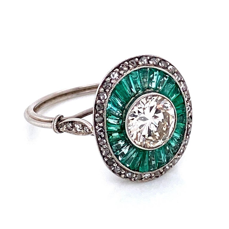 Beautiful Solitaire Cocktail Platinum ring. The center securely set with a 7mm Transitional cut diamond, weighing approx. 1.35 carat; surrounded by long light emerald baguettes approx. 1.50 total carat weight and 0.36tcw side diamonds. Handmade