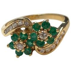 Diamond and Emerald Ring in 14 Karat Yellow Gold.