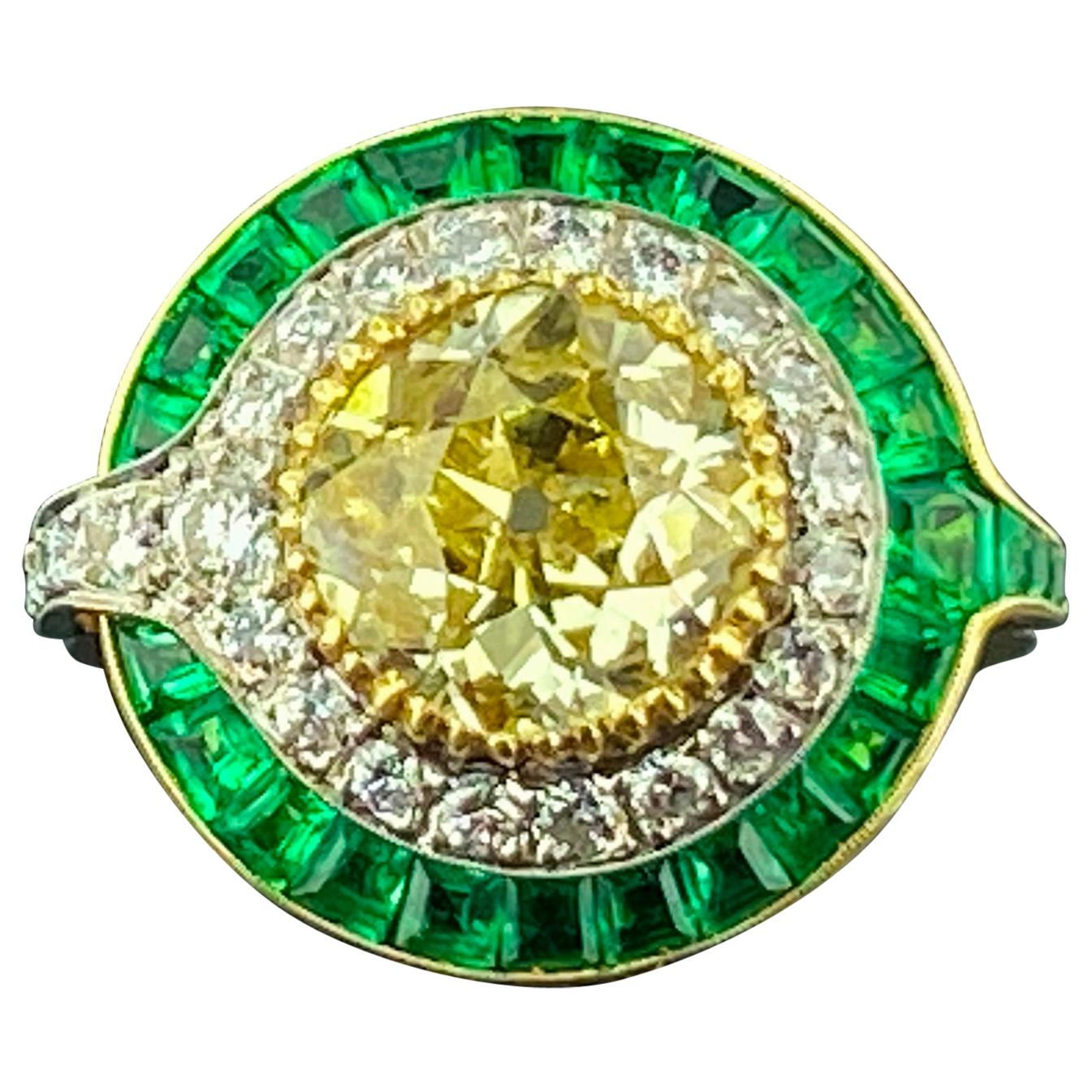 Diamond and Emerald Ring in 18 Karat White and Yellow Gold