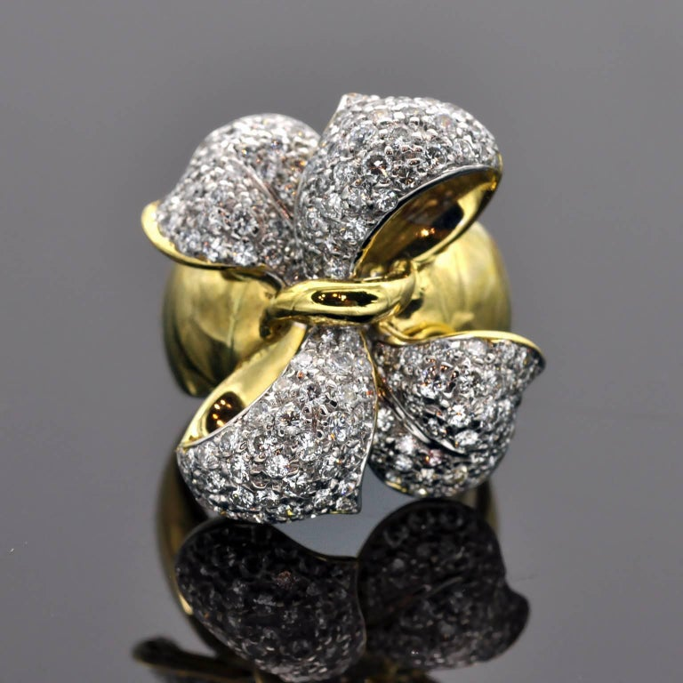 Stunning earring and ring set in the shape of an elegant bow . The Clip-on Earring are pave set with 5.26 carat of diamonds, the Ring set with 1.85 carat of diamonds both G VS.
