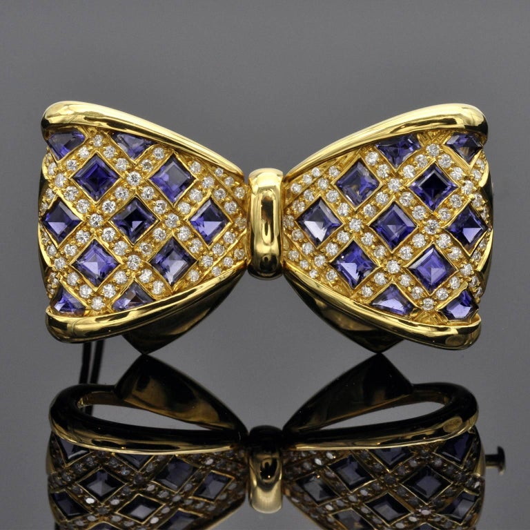 Classy square Iolite and diamond bowtie brooch. Diamond: ± 2 carat G VS or better 18kt Gold