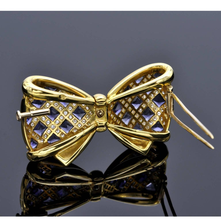 Modern Diamond and Iolite Gold Bowtie Brooch For Sale