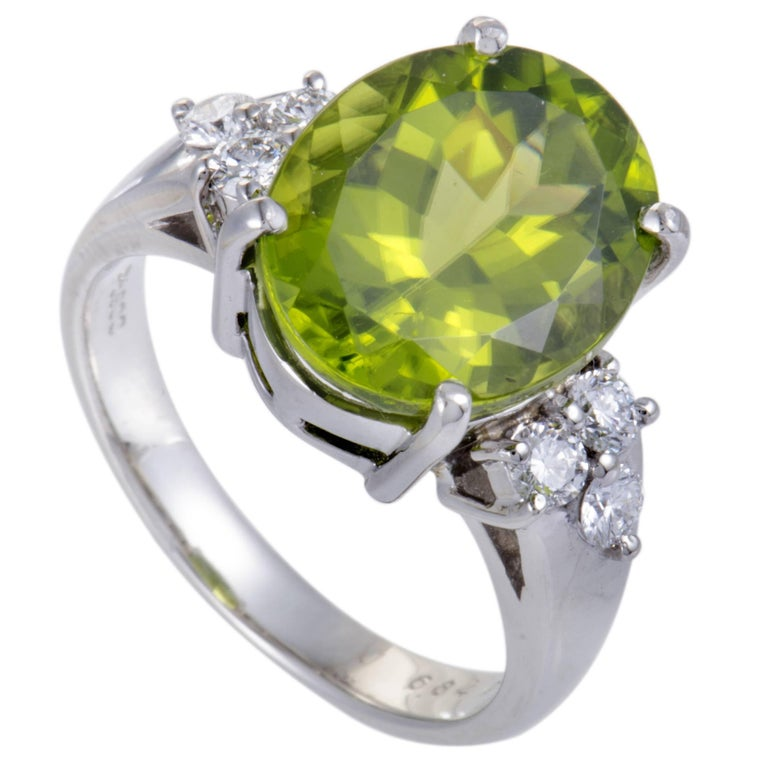 Diamond and Oval Peridot Platinum Ring