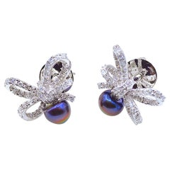 Diamond and Pearl Bow Earrings in 18 Karat White Gold
