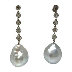 Diamond and Pearl Dangle Earrings in Platinum