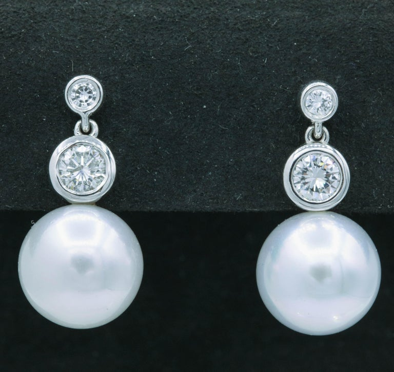 Contemporary Diamond and Pearl Drop Earrings, 0.92 Carat For Sale