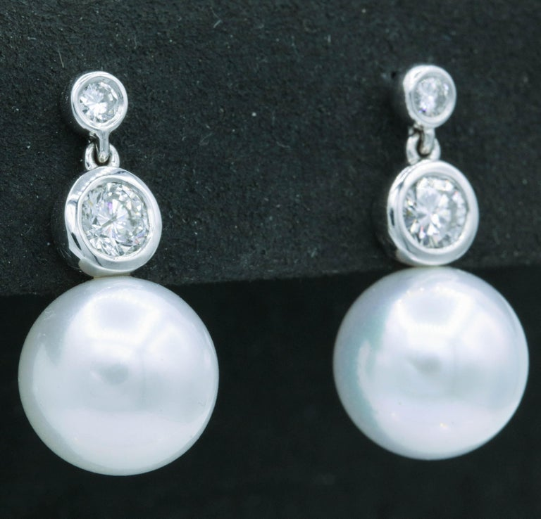 Round Cut Diamond and Pearl Drop Earrings, 0.92 Carat For Sale