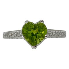 Diamond and Peridot Engagement Ring in 18 Karat White Gold