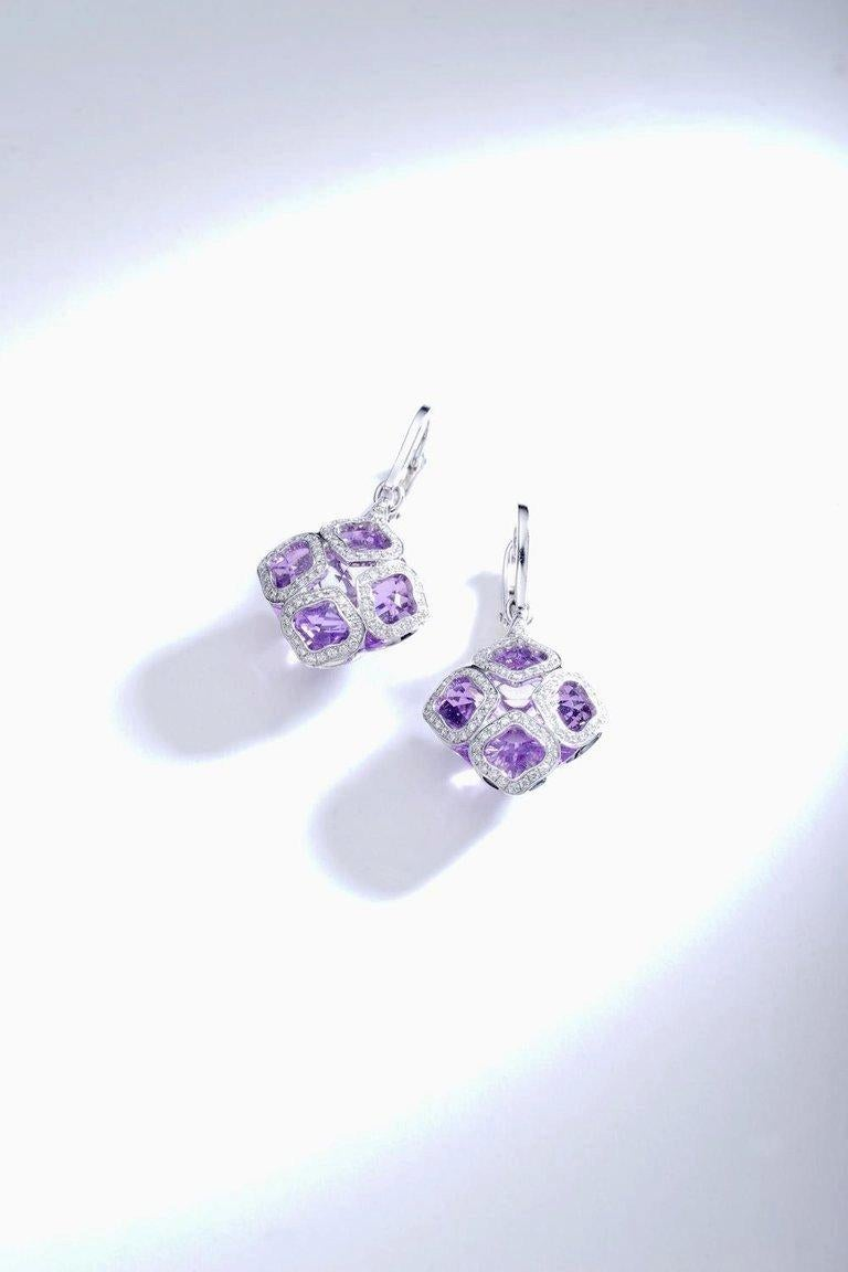Chopard Imperiale Amethyst and Diamond on white Gold 18k Earrings. Chopard signed and numbered. Total height: 1.57 inch (4.00 centimeters).  Pave Diamonds: 0.63 carat. With 2 Faceted Amethysts Centers: 11.60 carats.  Contemporary work. Imperiale