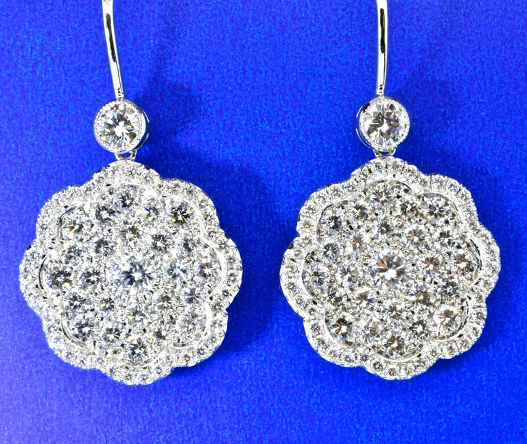 Diamonds are pave set, fine white, well matched and well cut stones.  They are all G/H, VS quality.  The total diamond weight is 4.49 cts. These earrings are hand made displaying fine craftsmanship.  They are now for a pierced ear, but can be
