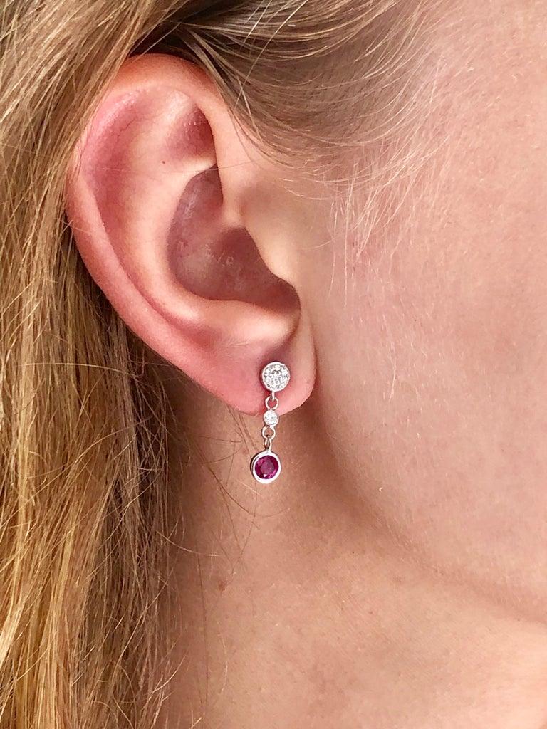 Fourteen karat white gold drop earrings 0.75