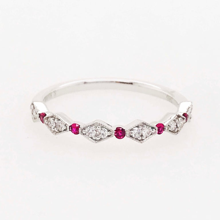 The dainty ruby and diamond band is precious in every way. With genuine natural ruby gemstones alternating between beautifully set natural white diamonds. The ring is a thin, classic design with round rubies accenting the piece. In between each ruby