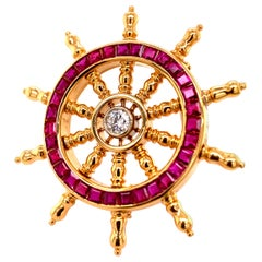 Diamond and Ruby Sailboat Steering Wheel Brooch in 18 Karat Yellow Gold