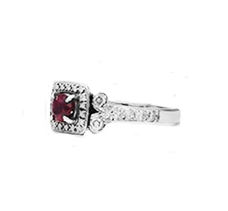 Contemporary Diamond and Ruby Solitaire Halo 1 Carat Ring For Sale