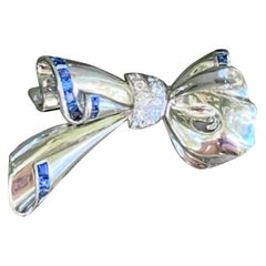 Diamond and Sapphire 18 Karat White Gold Bow Brooch Pin