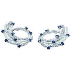 Diamond and Sapphire Earrings with White Enamel in 18 Karat White Gold