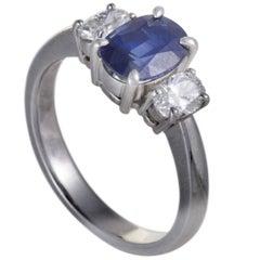 Diamond and Sapphire Platinum Three-Stone Ring