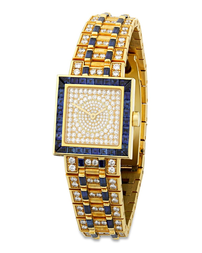This eye-catching Quadrato wristwatch was crafted by the high-end Italian jeweler Bulgari. An array of pavé-set white diamonds totaling approximately 4.51 carats adorn the watch, which is crafted of 18K yellow gold in a dazzling link design. Deep