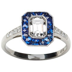 Diamond and Sapphire Ring 0.69 Carat E VS2