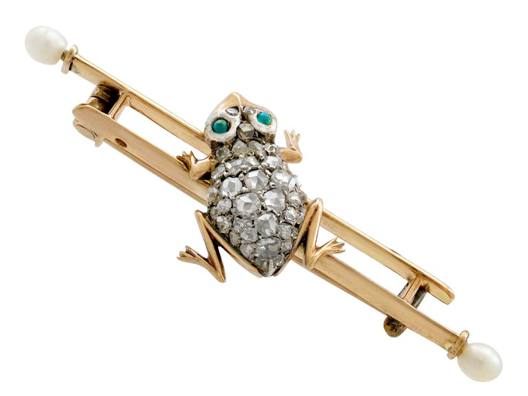 An impressive 0.70 carat diamond and seed pearl, imitation green gemstone and 9 karat yellow gold, silver set 'frog' brooch; part of our diverse antique jewellery and estate jewelry collections.  This fine and impressive Victorian brooch has been