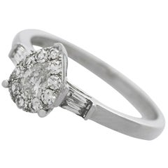Diamond and White Gold Solitaire Ring with Accents