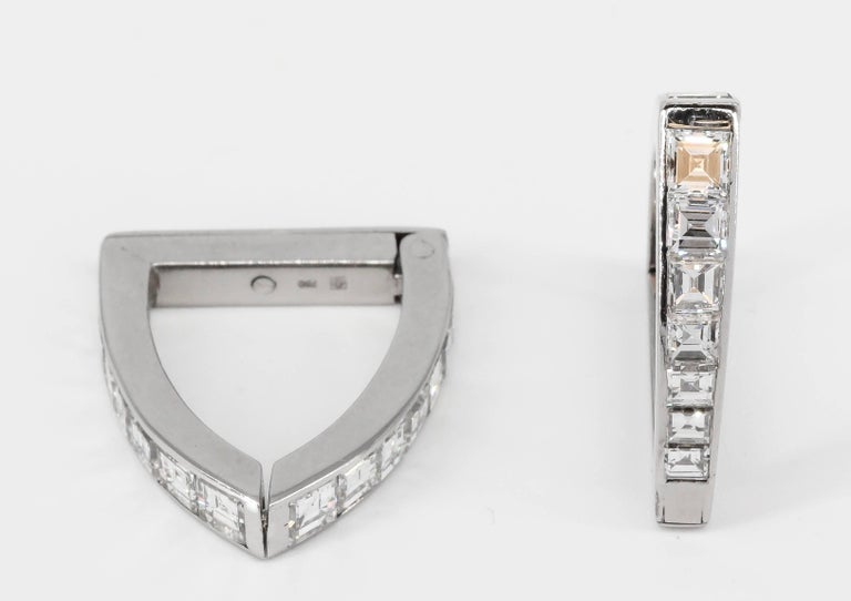 Handsome diamond and 18k white gold cufflinks. They feature high grade square step cut diamonds throughout, approx. 4-5 carats.  Hallmarks: 750, maker's mark.