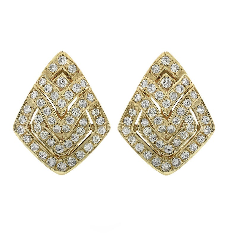 Gorgeous earrings crafted in yellow gold, featuring 92 round brilliant cut diamonds weighing approximately 2 carats total, G color, SI clarity. The diamonds are set in a striking open metal work design with stunning geometric patterns. The earrings