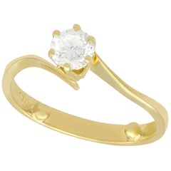 Diamond and Yellow Gold Solitaire Twist Ring