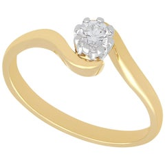 Diamond and Yellow Gold Twist Solitaire Engagement Ring