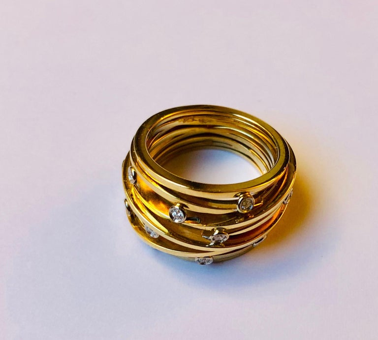 The Ferns ring is inspired by nature. All bands were individually made by hand and polished to a mirror finish before being soldered together in an organic design. This ring was designed and made by Van der Veken, an Antwerp, Belgium-based High