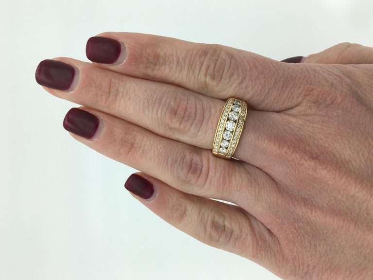 This stunning diamond band features approximately 1.01CTW of Round Brilliant Cut Diamonds set in 14K yellow gold.  Diamond Cut: Round Brilliant Cut  Average Diamond Color: G-I Average Diamond Clarity: SI1-I Diamond Carat Weight:  Approximately