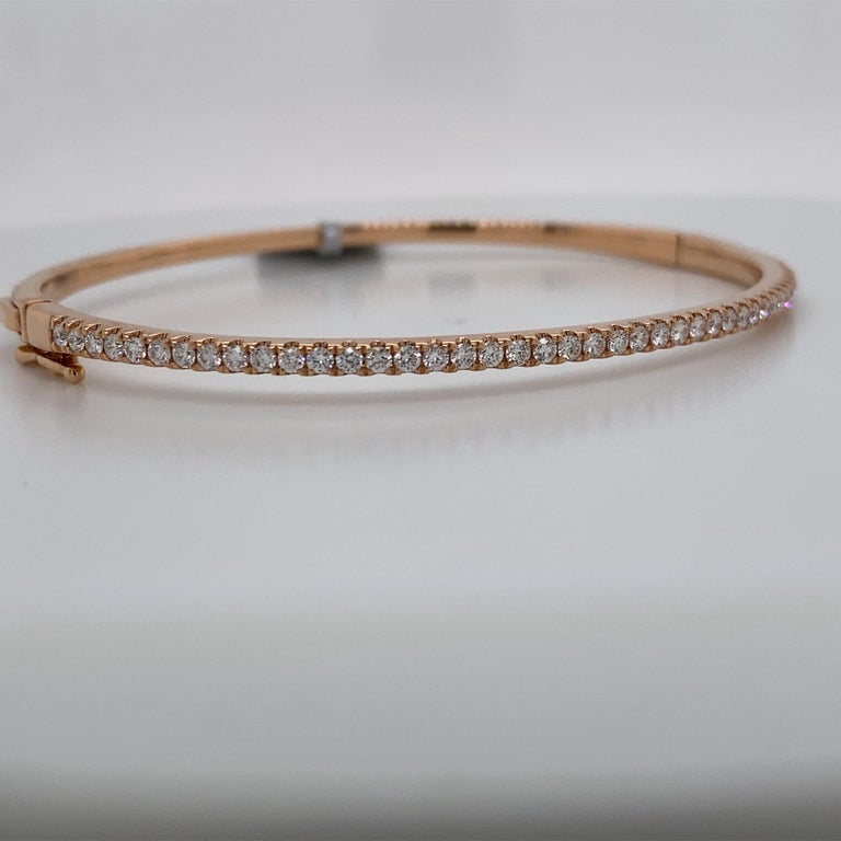 18K Rose gold bangle bracelet featuring 45 round brilliants weighing 0.85 carats.  Great for stacking! Available in yellow & white gold.